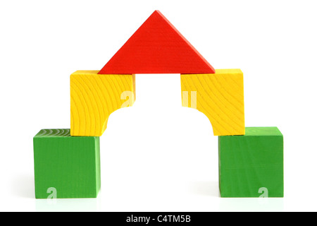 House made from children's wooden building blocks - Stock Photo