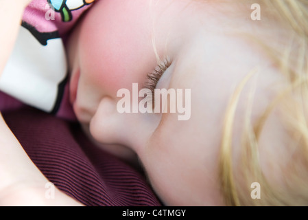 Baby girl napping, close-up - Stock Photo