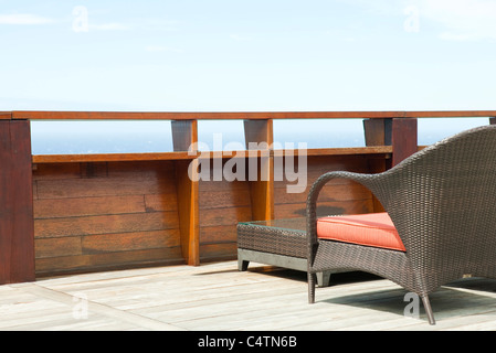 Wicker patio furniture on deck - Stock Photo