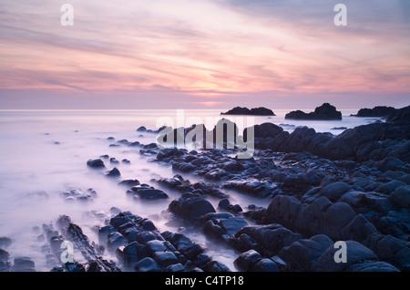 Rocky shoreline at Sunset at Hartland Quay. Devon. England. UK. - Stock Photo
