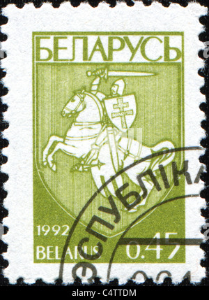 BELARUS - CIRCA 1992: A stamp printed in Belarus shows coat of arms of Belarus, circa 1992 - Stock Photo