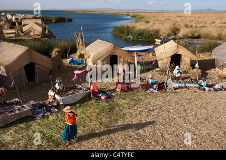 Daily activity in a village on one of the floating islands of Uros on Lake Titicaca in Peru - Stock Photo