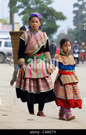 Mother and daughter of the Flower Hmong Ethnic Minority People walking in Bac Ha Vietnam - Stock Photo