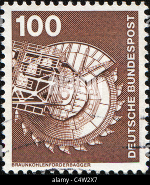 WEST GERMANY - CIRCA 1975: A stamp printed in West Germany  shows rotary excavator, circa 1975 - Stock Photo