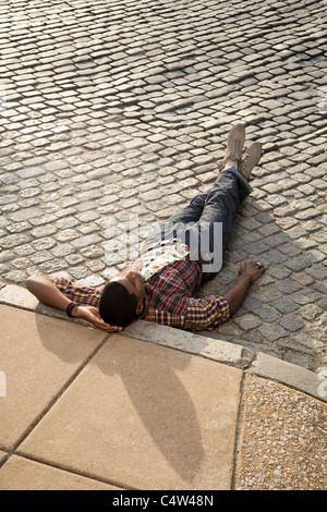 Man Laying Down on Road