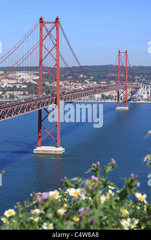 Lisbon Portugal the Ponte 25 de Abril suspension bridge across the River Tagus seen from the north shore - Stock Photo