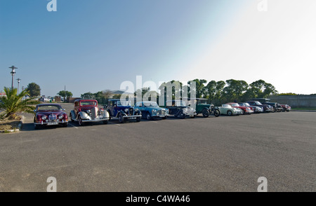 Lineup of old historic classic and vintage cars which were taking part in a motor rally in Cape Town, South Africa. - Stock Photo