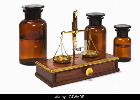 Detail photo of a old druggist balance alongside are three pharmacists bottles - Stock Photo