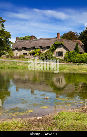 Ashmore pond and Thatched Cottage, Ashmore, Dorset, England, UK