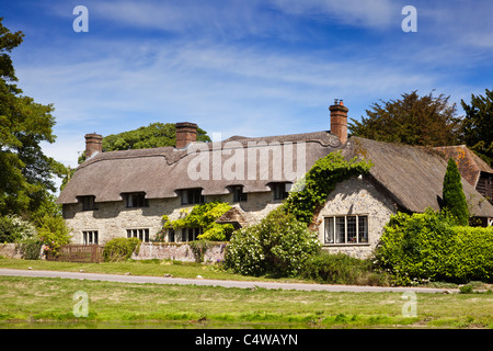 Beautiful old detached house thatched country cottage in the village of Ashmore, Dorset, England, UK in summer - Stock Photo