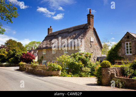 Thatched Cottage country house in the pretty English village of Ashmore, Dorset, England, UK - Stock Photo
