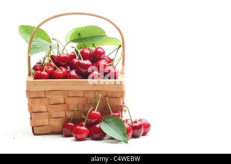 Basket with sweet cherries isolated on white background. - Stock Photo