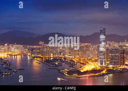 View of International Commerce Centre (ICC) and West Kowloon at dusk, Hong Kong, China - Stock Photo