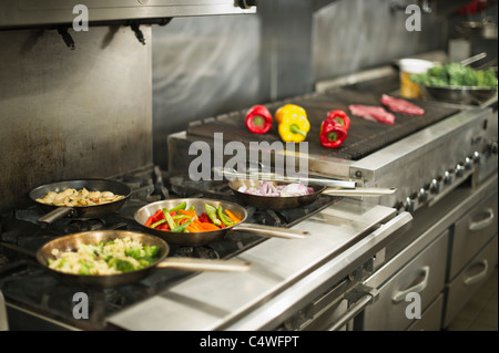 USA, New York State, New York City, Food in commercial kitchen - Stock Photo
