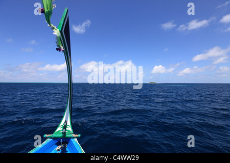 Dhoni Boat approaching a deserted island - Stock Photo