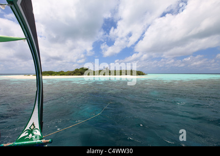 Dhoni Boat anchored off a deserted island - Stock Photo