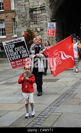 Trade Unionists & Socialist Party members protesting against public service cuts enter the historic city of Winchester - Stock Photo
