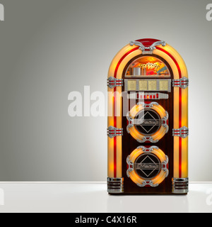 Old retro jukebox in an empty room with nice illumination, copy space ready - Stock Photo