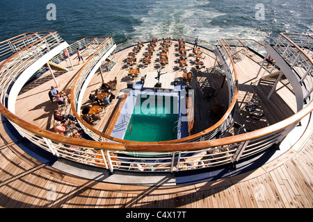 Pool and lido deck of a cruise ship in sunshine - Stock Photo