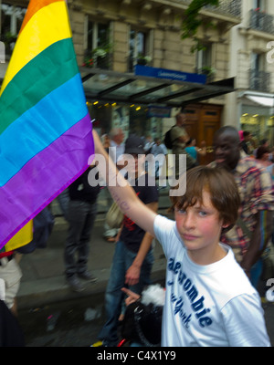 CANADA20 August Ayoung boy wearing a rainbow cloat is hugging a young woman at Montreal Gay Pride Pa