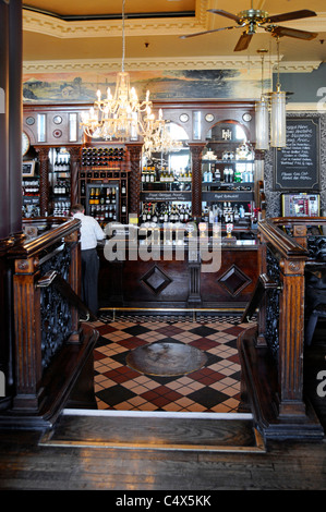 Interior of London pub bar counter at The Horniman before lunchtime rush at Hays Galleria beside River Thames - Stock Photo
