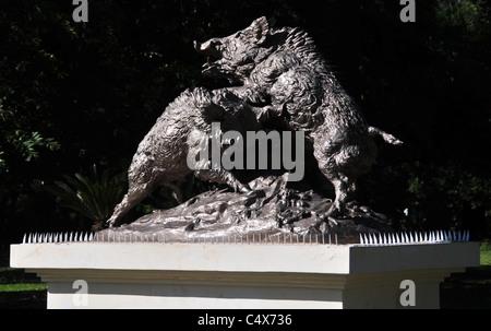 Bronze sculpture two fighting wild boars on white plinth, Avenida Libertador, Parque General San Martin, Mendoza, - Stock Photo