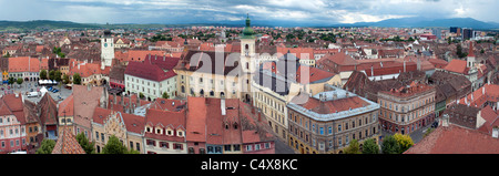 Panorama of old town Sibiu in Transylvania Romania: Council tower, Small Square, Catholic Church and other old buildings - Stock Photo