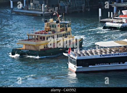 Ferry Boats Come and Go on Regular Schedules From Circular Quay Sydney Harbour to Outlying Districts NSW Australia - Stock Photo