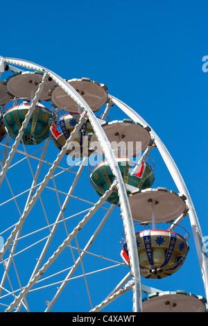 Ferris wheel close up on a blue sky - Stock Photo