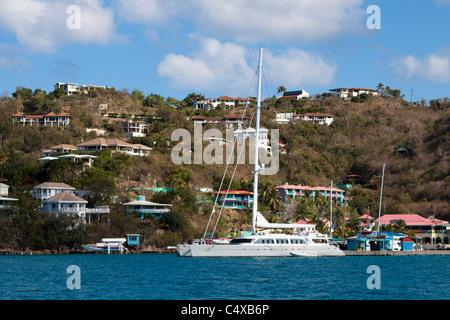 Luxury sailboat docked at Leverick Bay with hillside homes on Virgin Gorda in British Virgin Islands