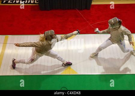 Mariel Zagunis (USA) competing against Alina Komashuk (UKR) the 2011 New York Saber World Cup. - Stock Photo