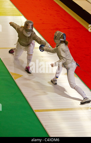 Mariel Zagunis (USA) competing against Galyna Pundky (UKR) the 2011 New York Saber World Cup. - Stock Photo