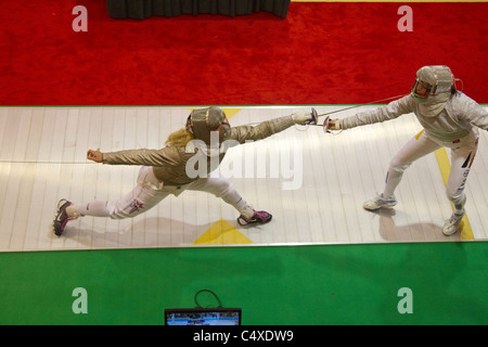 Mariel Zagunis (USA) competing against Anna Limbach (GER) the 2011 New York Saber World Cup. - Stock Photo
