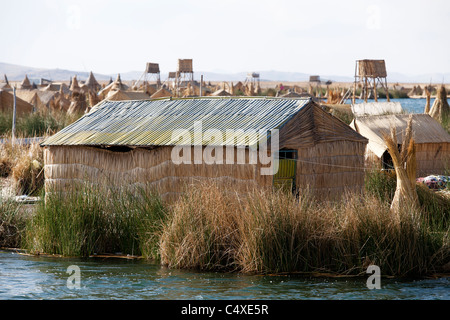 A hut made from torta or reeds on the floating islands of Uros on Lake Titicaca in the Peruvian Andes - Stock Photo