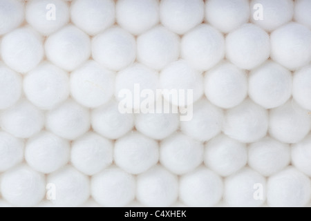 A group of cotton swabs against a white background - Stock Photo