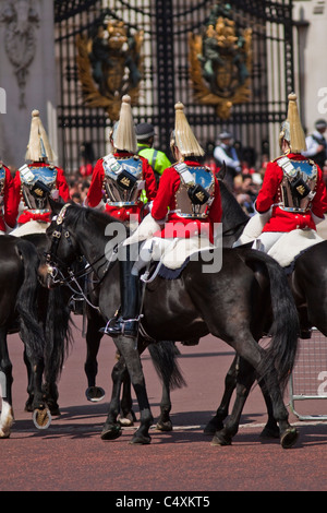 Blues & Royals of the Household cavalry passing Buckingham palace - Stock Photo