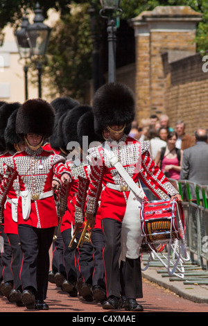 Welsh guards marching band returning to Wellington barracks after the Changing of the guard - Stock Photo