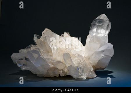 Quartz crystal cluster horizontal on black background - Stock Photo