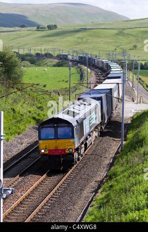 British Railways  Direct Rail Services Diesel  DRS 66420   Long Goods train ascending Shap, West Coast Line, Cumbria, - Stock Photo