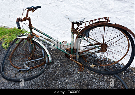A Rusty Old Bicycle Leans Against a Wall at Cape Otway Lightstation Great Ocean Road near Apollo Bay Victoria Australia - Stock Photo