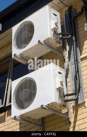 Air conditioning ventilation and cooling fans using heat exchange on the exterior of the leisure centre in Cowbridge, - Stock Photo