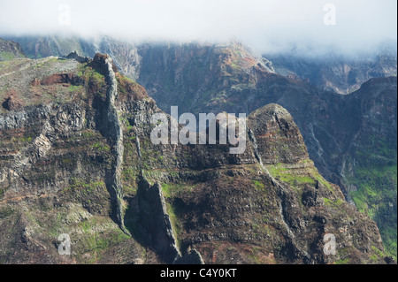 Volcanic Dikes in fog-shrouded mountains, Madeira Island, Portugal - Stock Photo