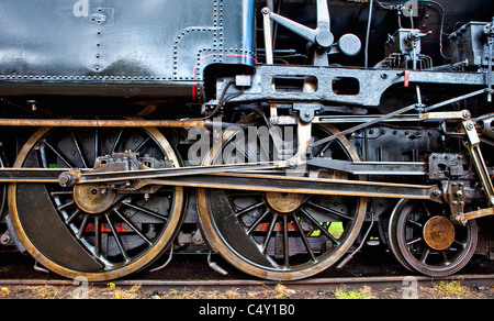 wheels of an old steam locomotive standing on rail - Stock Photo