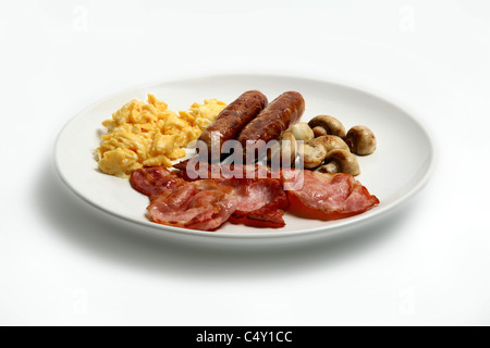 Sausage, bacon, mushrooms and scrambled egg on a white plate - Stock Photo