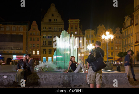 The fountain on the market square in Wroclaw in the evening, Poland - Stock Photo