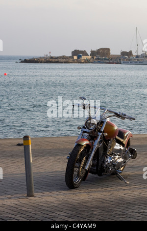 A Harley Davidson on the sea front of The Mediterranean Sea in Pafos Cyprus - Stock Photo