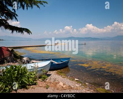 Children swim from a jetty in the sleepy fishing village of Radožda, near Struga on the western shores of Lake Ohrid, - Stock Photo