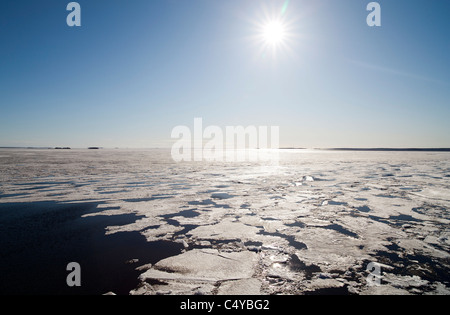 Blocks of melting sea ice float to the shore , Oulu , Bothnian Bay , Baltic Sea , Finland - Stock Photo