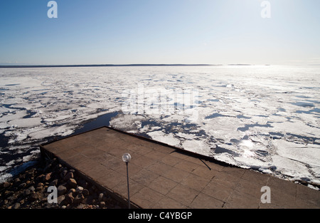 Blocks of melting sea ice float to the shore , Oulu Bothnian Bay , Baltic Sea , Finland - Stock Photo