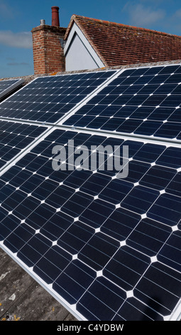 Solar panels installed on roof of residential house in England - Stock Photo